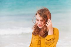 Portrait of smiling Caucasian teenage girl. Outdoor portrait of smiling Caucasian teenage girl with red hair on the ocean coast in Dominican Republic royalty free stock images