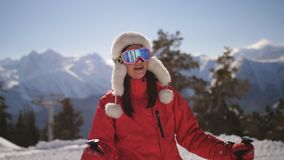 Tired woman skier at a ski resort on top of a mountain. stock footage