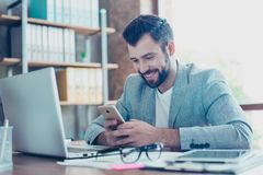 Portrait of smiling, caucasian, young finansist texting, flirti royalty free stock photography