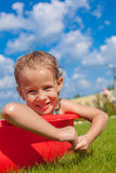 Portrait of smiling charming little girl enjoying Royalty Free Stock Photography