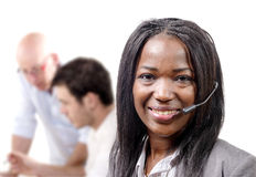 Portrait of smiling cheerful african support phone operator in h. A portrait of smiling cheerful african support phone operator in headset royalty free stock photo
