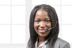 Portrait of smiling cheerful african support phone operator  Stock Photos