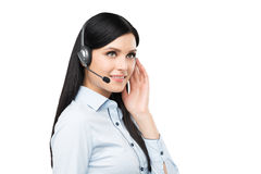 Portrait of smiling cheerful support phone operator in headset. Stock Image