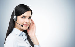 Portrait of smiling cheerful support phone operator in headset. Royalty Free Stock Photos