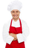 Portrait of a smiling chef with arms crossed Stock Images