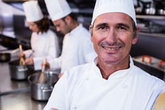 Portrait of smiling chef in commercial kitchen Stock Photos