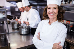 Portrait of smiling chef in commercial kitchen Stock Image