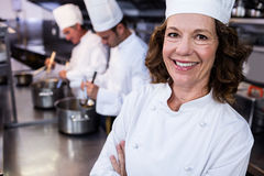 Portrait of smiling chef in commercial kitchen Royalty Free Stock Photos