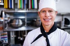 Portrait of smiling chef in commercial kitchen Stock Photography