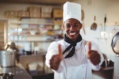 Portrait of smiling chef showing thumbs up Royalty Free Stock Images