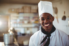 Portrait of smiling chef. Standing in commercial kitchen stock photo