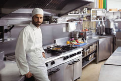 Portrait of smiling chef standing in commercial kitchen. At restaurant royalty free stock photo