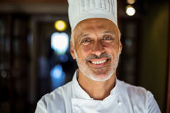 Portrait of smiling chef. Standing in restaurant stock photos