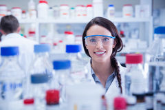 Portrait of a smiling chemist wearing safety glasses. In lab Royalty Free Stock Photos
