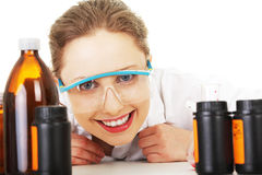 Portrait of a smiling chemist working Stock Images