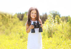Portrait of smiling child with binoculars outdoors Stock Photography