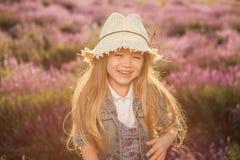 Portrait of smiling child. Contre-jour sunset shot. Stock Photo