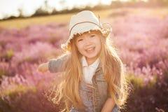 Portrait of smiling child. Contre-jour sunset shot. Stock Photos