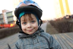 Smiling child with crash helmet Stock Image
