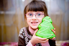 Portrait of smiling child girl with gingerbread Royalty Free Stock Photography
