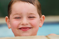 Portrait of smiling child at side of pool Royalty Free Stock Photo