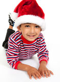 Portrait of a Smiling Child Wearing Santa Hat Royalty Free Stock Photos