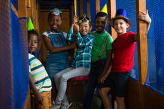 Portrait of smiling children in jungle gym royalty free stock image