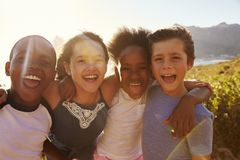 Portrait Of Smiling Children Standing On Cliffs By Sea Royalty Free Stock Photography