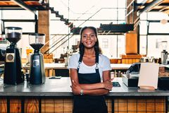 Portrait of a smiling coffee shop owner stock image