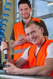 Portrait of a smiling collaborators from factory Stock Photos