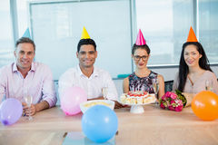 Portrait of smiling colleagues celebrating birthday of woman Stock Photo