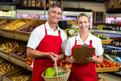 Portrait of smiling colleagues. At supermarket Stock Photography