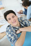 Portrait of smiling college boy attending class Royalty Free Stock Image