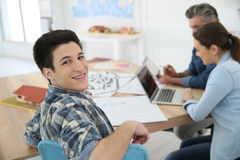 Portrait of smiling college boy attending class Stock Images