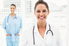 Portrait of a smiling confident female doctor Royalty Free Stock Image