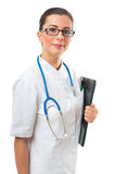 Portrait of smiling confident woman doctor with clipboard Royalty Free Stock Photography