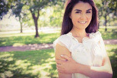 Portrait of smiling confident woman in park Royalty Free Stock Photography