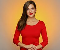 Portrait of smiling confident woman in red dress. Royalty Free Stock Photos