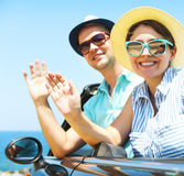 Portrait of a smiling couple at beach in the car Royalty Free Stock Images