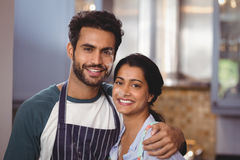 Portrait of smiling couple embracing in kitchen Royalty Free Stock Photo
