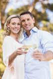 Portrait of smiling couple embracing and toasting with wineglass Royalty Free Stock Images