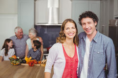 Portrait of smiling couple with family in kitchen Royalty Free Stock Images