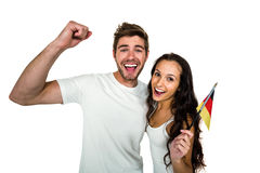 Portrait of smiling couple holding German flag Stock Photography