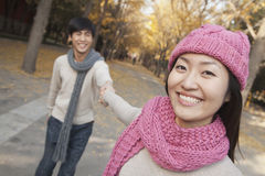 Portrait of Smiling Couple Holding Hands in Park Stock Photos