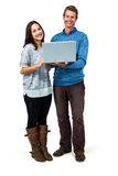 Portrait of smiling couple holding laptop Stock Images