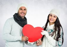 Portrait of smiling couple holding red hearts Stock Images