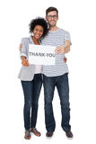 Portrait of a smiling couple holding a thank you note Stock Photos