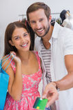 Portrait of smiling couple paying by credit card Royalty Free Stock Photo