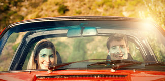 Portrait of smiling couple in red cabriolet Stock Photo