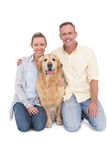 Portrait of smiling couple sitting together with their dog Stock Images